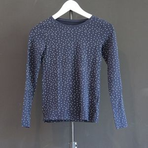 navy and  white polka dotted shirt
